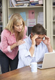 Worried Couple Working In Home Office Together Stock Photos