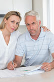 Worried couple working out their finances Royalty Free Stock Images
