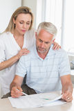 Worried couple working out their finances Stock Images