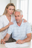 Worried couple working out their finances Royalty Free Stock Photos