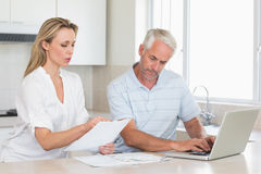 Worried couple working out their finances with laptop Royalty Free Stock Image