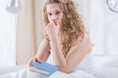 Worried curly girl in bed Royalty Free Stock Photo