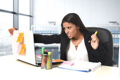 Worried and desperate businesswoman suffering stress working at office computer desk Royalty Free Stock Photo