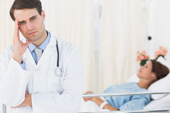 Worried doctor with patient in hospital Royalty Free Stock Photography