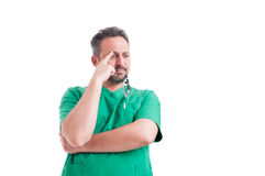 Worried doctor thinking Stock Photo