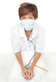 Worried doctor w surgical mask Royalty Free Stock Photos