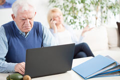Worried elder man working Stock Photos