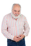 Worried elderly man with stomach pain Stock Photo