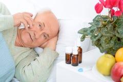 Worried elderly patient is calling somebody Stock Photos