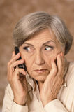 Worried elderly woman Royalty Free Stock Photos