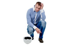 Worried engineer holding his head Stock Images