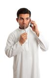 Worried ethnic man on phone Stock Photo