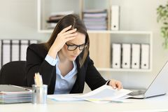 Worried executive checking a negative chart. Worried executive checking sales decrease in a negative chart Stock Photos