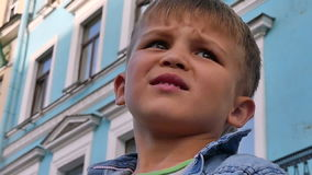 Worried face little boy lost city stock video footage