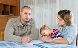 Worried family with financial documents Stock Photography
