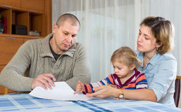 Worried family with financial documents Stock Image