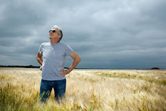 Worried farmer. Worried farmer  scrutinizing a threatening cloudy sky Royalty Free Stock Images