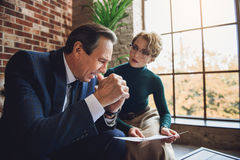 Worried female advisor speaking to client Royalty Free Stock Images