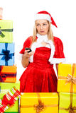 Worried female Christmas Santa with mobile phone Royalty Free Stock Photography