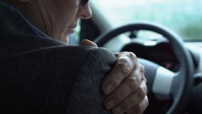 Worried female driver massaging painful shoulder, old trauma result, health