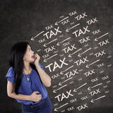 Worried female entrepreneur with tax pressure Royalty Free Stock Image
