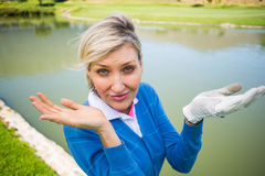 Worried female golfer looking for golf ball Stock Image