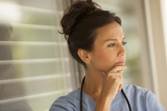 Worried female medical doctor Stock Image