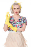 Worried fifties housewife with sink plunger, humorous concept, s. Happy fifties housewife putting on rubber gloves, humorous concept, isolated on white stock photo