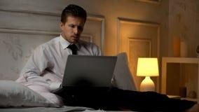 Worried financial expert working on report, errors in documents, deadline stock photos