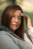 Worried forçou a mulher madura atrativa Fotografia de Stock Royalty Free