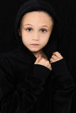 Worried Girl in Black. Beautiful 7 year old girl in black with worried expression royalty free stock photography