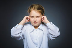 Worried girl covering her ears, observing. Hear nothing Royalty Free Stock Photo
