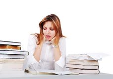 Worried girl between lot of books Royalty Free Stock Image