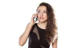 Worried girl on the phone Stock Image