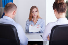 Worried girl shows her CV Royalty Free Stock Photo