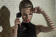 Worried girl talking on phone Royalty Free Stock Images