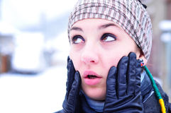 Worried girl in winter set-up. Young woman in winter accessories looking worried Royalty Free Stock Photo