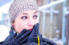 Worried girl in winter set-up. Young woman in winter accessories looking worried Royalty Free Stock Image