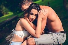 Worried girlfriend hugging with her boyfriend Royalty Free Stock Photos
