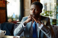 Worried Handsome Businessman in Cafe Stock Image