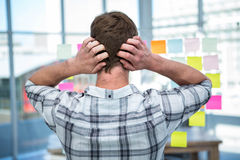 Worried hipster man in front of post-it Royalty Free Stock Photography