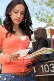 Worried Hispanic Woman Checking Mailbox Stock Photos