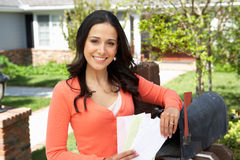 Worried Hispanic Woman Checking Mailbox Royalty Free Stock Photography