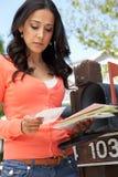 Worried Hispanic Woman Checking Mailbox Stock Photo