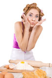 Worried housewife with rollers baking Royalty Free Stock Photos