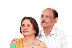 Worried indian couple. Senior indian couple looking up with expression of worry or thoughtfulness Stock Photo