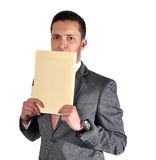 Worried about an interview. A young adult, in formal clothes with his file, worried about his interview or meeting Royalty Free Stock Photography