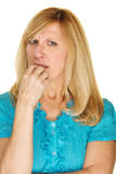 Worried Lady Biting Fingernails. Single isolated worried adult female biting fingernails Royalty Free Stock Images