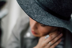 Worried lady wearing fashionable hat