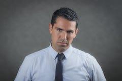 Worried latino business man Stock Image